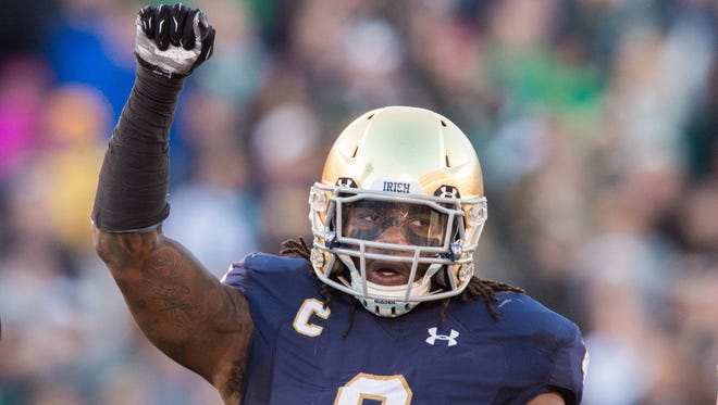 Notre Dame Fighting Irish linebacker Jaylon Smith (9) celebrates in the second quarter against the Wake Forest Demon Deacons at Notre Dame Stadium.