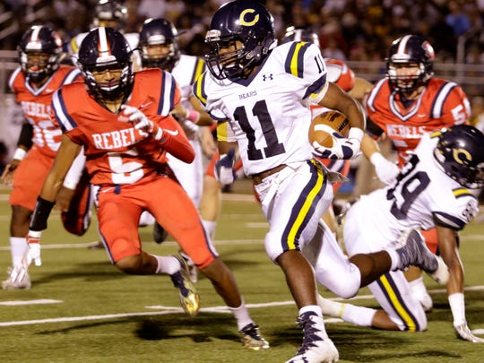 Treylon Barnaba tries to get to the outside in the first quarter of Carencro's game with the Teurlings Rebels on Friday night at Teurlings.
