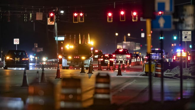 Traffic patterns continue to change during evening construction on the intersection of Forest Hill Boulevard and Southern Boulevard in Wellington, July 15, 2020. Signal lights at the intersection are being moved to allow more lanes in each direction.