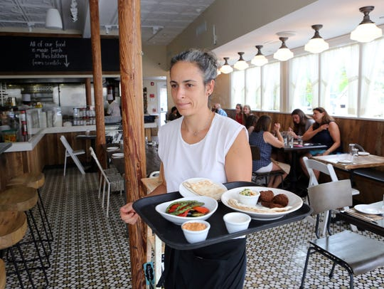 Owner Tania Rahal serves lunch at Rosemary and Vine