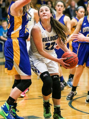 Metuchen's Brynn Farrell (22) looks to shoot under pressure from Spotswood's Erin Malia (23) at Metuchen  in the GMC Tournament on February 13, 2017. (Keith A. Muccilli, correspondent)