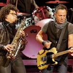 Bruce Springsteen & The E Street Band perform in concert on Feb. 23 in Cleveland. Jake Clemons, left, plays the saxophone.