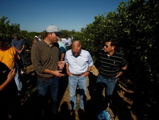 U.S. Sens. Bill Nelson, center, and Marco Rubio, right,
