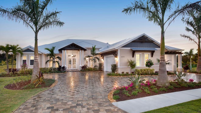Florida Lifestyle Homes' Siesta Key model in Parrot Cay at Naples Reserve.
