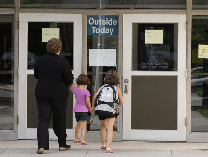 Families enter the doors of Cooper Elementary School Tuesday August 26, 2014 in Sheboygan.