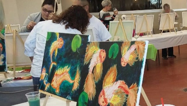 Participants finish up their painting at St. Clair Winery's Saturday Sip and Paint event. For $35, beginning painters can sip a glass of wine and learn the finer points and introductions to painting.