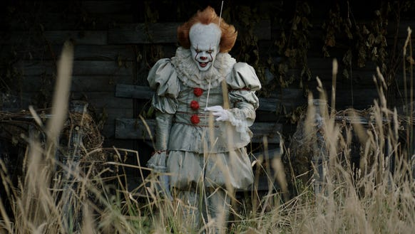 Bill Skarsgård lurks as the evil Pennywise in 'It.'