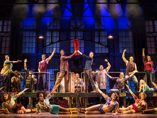 The cast of 'Kinky Boots' displays the production's titular boots.