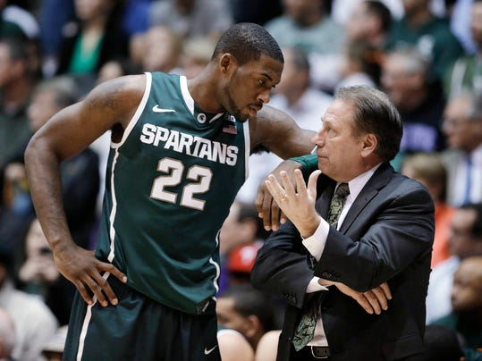 FILE - In this Jan. 15, 2014, file photo, Michigan State guard Branden Dawson, left, listens to coach Tom Izzo during an NCAA college basketball game against Northwestern in Evanston, Ill. Dawson is staying for his senior season. The school announced Dawson's decision Tuesday, April 15, 2014. He averaged a career-high 11.2 points last season.  (AP Photo/Nam Y. Huh, File)