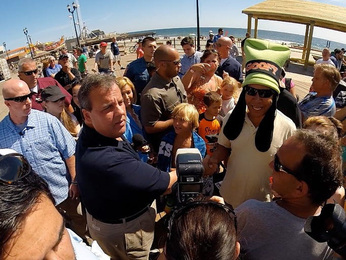 "Wearing a ""Goofy"" hat, Thomas Adames from Sparta, NJ, greets New Jersey Governor Chris Christie on the Seaside Heights, NJ, boardwalk Friday morning, August 29, 2014.  With the start of the final summer weekend underway, the Governor also visited the Point Pleasant Beach boardwalk."
