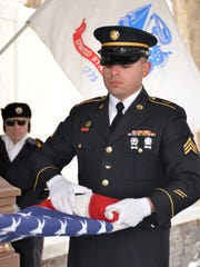 A member of the New York Army National Guard at a Dec, 15 burial at the Gerald B.H. Solomon Saratoga Cemetery in Schuylerville N.Y.
