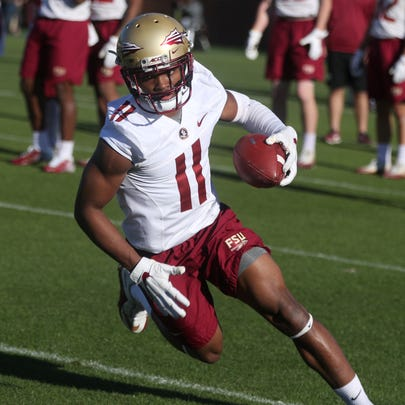 FSU's Nyqwan Murray runs with the ball during spring