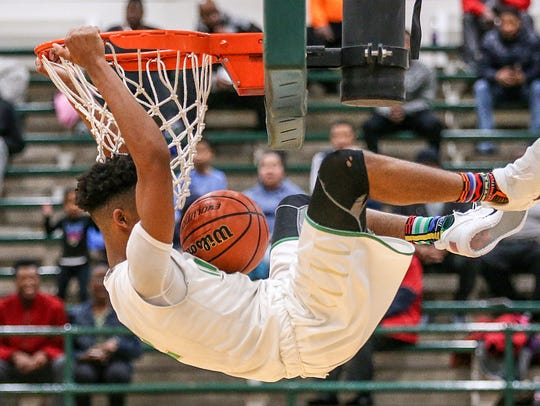 Cathedral guard Armaan Franklin (2) dunks during the