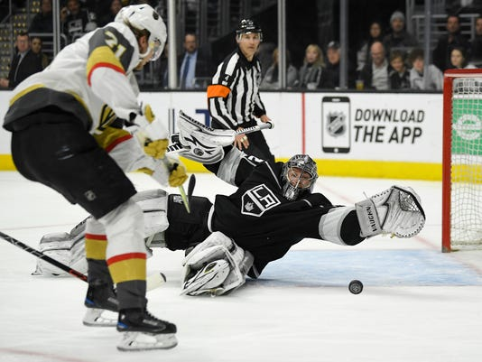 Los Angeles Kings goaltender Jonathan Quick, right, stops a shot by Vegas Golden Knights left wing Tomas Tatar, of Slovakia, during the third period of an NHL hockey game, Monday, Feb. 26, 2018, in Los Angeles. (AP Photo/Mark J. Terrill)
