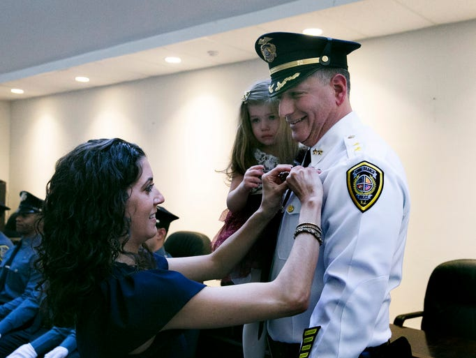 Long Branch Police Chief Jason Roebuck has his badge
