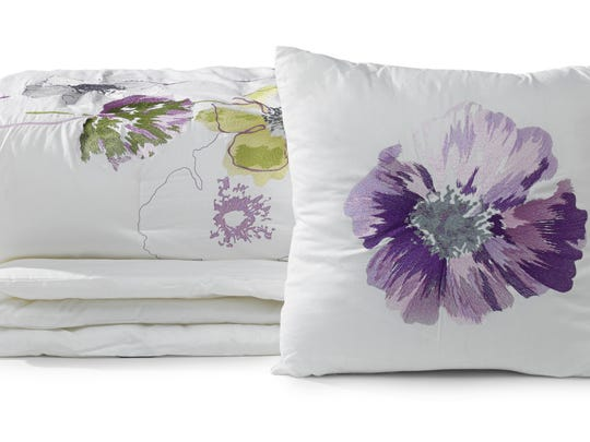 Bold blooms in on-trend lavender that bring the garden to the bedroom in a bedding set from HomeGoods.