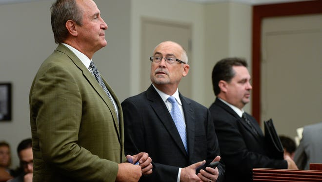 Former Utah Attorney General Mark Shurtleff, left, facing public corruption charges, appears in Judge Elizabeth Hruby-Mills courtroom alongside his attorney Richard Van Wagoner, center, in Salt Lake City on Monday, Sept. 28, 2015, for a pre-trial hearing. At right is Davis County prosecutor Troy Rawlings. Shurtleff, a Republican, has pleaded not guilty to seven counts of obstructing justice and accepting improper gifts.
