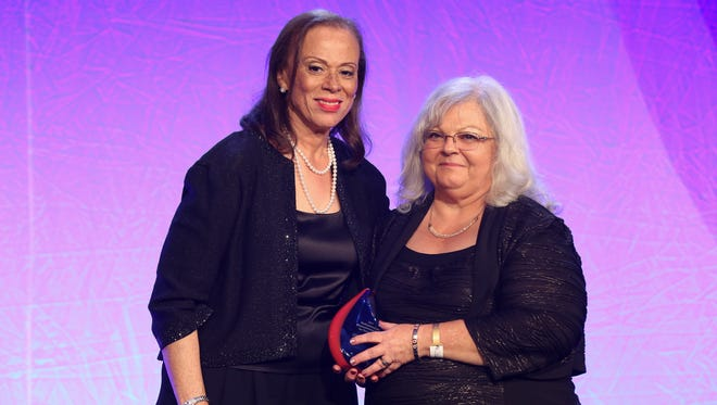 Lonnie Ali, left, widow of boxing great Muhammad Ali, presents the Muhammad Ali Social Justice Award to Susan Bro, right, as it was posthumously awarded to her daughter Heather Heyer during the Muhammad Ali Humanitarian Awards.  Heyer was killed while protesting white nationalists in Charlottesville, Va. Sep. 23, 2017Sep. 23, 2017