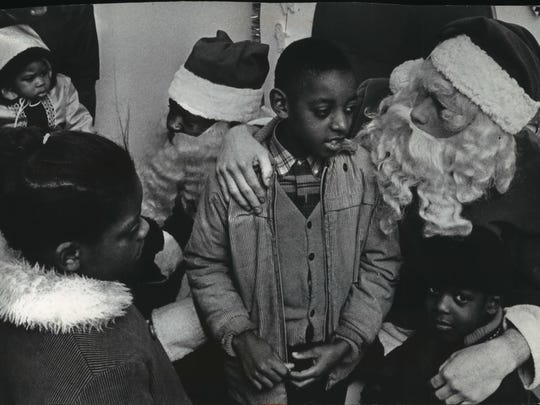 A black Santa Claus joins a white Santa on the Yuletide throne at the Gimbels-Schuster's store at 2153 N. 3rd St. (now King Drive) on Dec. 6, 1968. Fifty African-American children and 20 adults joined the black Santa in a march to the north side department store, as part of an effort to dramatize welfare complaints.