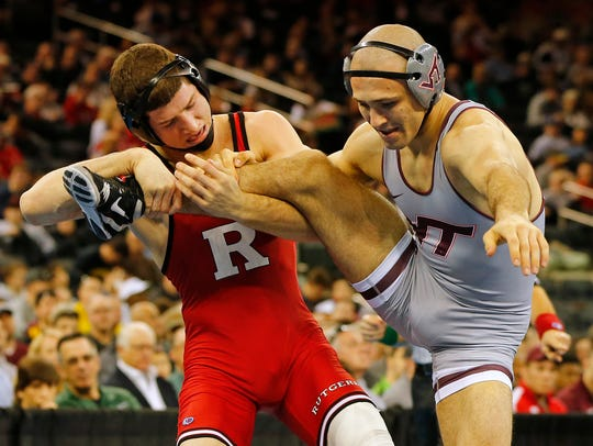 Anthony Ashnault of Rutgers battles Solomon Chishko