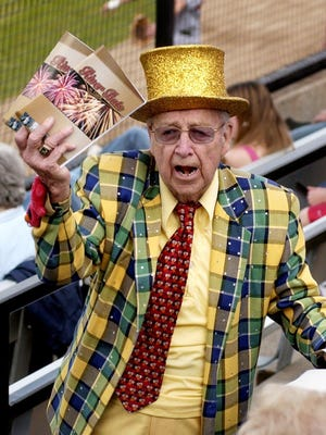 In this file photo, Jim Gammell sells programs in the stands at Dick Putz Field. Gammell has been selling programs and merchandise for area teams since 1954.