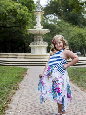 Nine year-old Kayla Kosmalski poses for a portrait in Brandywine Park in Wilmington on Thursday afternoon.
