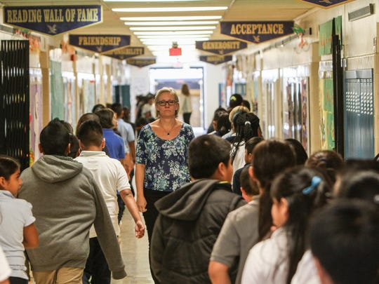Students and staff crowd the hallways of the Park Avenue Elementary School in Freehold.