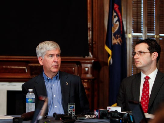 In this LSJ file photo, State Budget Director John Roberts, at right, sits with Gov. Rick Snyder and  Lt. Gov. Brian Calley as they present Snyder's 215 budget recommendations to the Legislature  on Thursday, June 12, 2014 at the Capitol.  [Photo June 12, 2014 by MATTHEW DAE SMITH | for the Lansing State Journal]