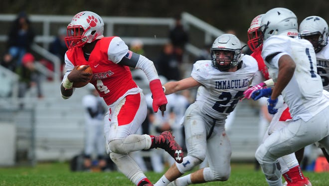 St. Joseph RB Qwahsin Townsel runs the ball in Saturday's Non-Public Group 2 semifinal against Immaculata. The top-seeded Wildcats won, 64-26.