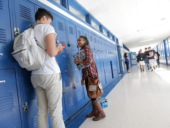 Eastwood High School students visit their lockers between