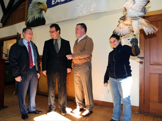 In 2017, then-Westchester County Executive Rob Astorino, Kevin Carter, the executive director of Teatown Lake Reservation in Ossining, and State Sen. Terrence Murphy chat as Lisa Kelly, the animal care supervisor holds Blaze, a red tailed hawk.