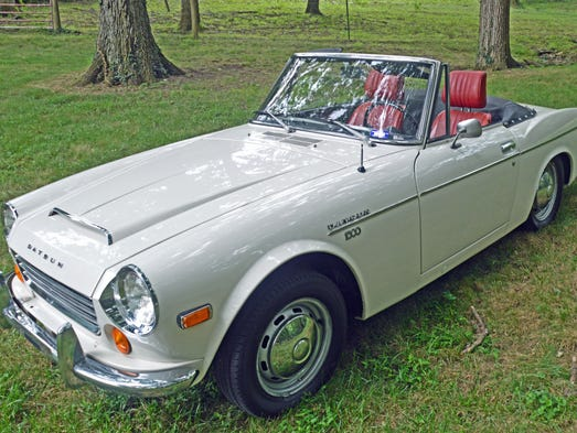 Long gone from Nissan's lineup is this 1970 Datsun 1600 roadster, a two-seat sports car.
