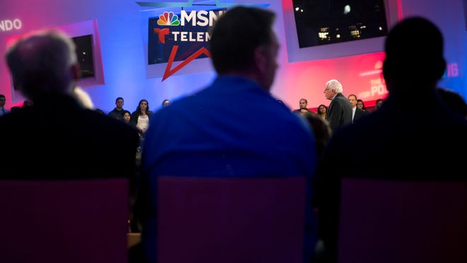 Democratic presidential candidate Sen. Bernie Sanders, I-Vt., right, speaks at an MSNBC town hall, Thursday, Feb. 18, 2016, in Las Vegas.