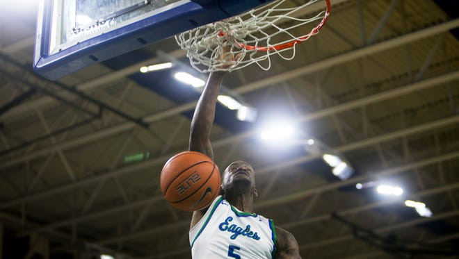 Florida Gulf Coast University sophomore, Zach Johnson, #5, dunks the ball during the game against Stetson University on Thursday, February 23, 2017 at Alico Arena in Estero. With an 80-70 win, the Eagles clinched the Atlantic Sun regular-season title and the No. 1 seed in the conference tournament.