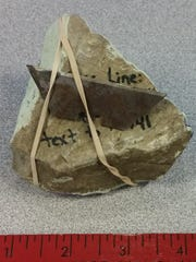 A painted rock found in Green Bay with rusty razor