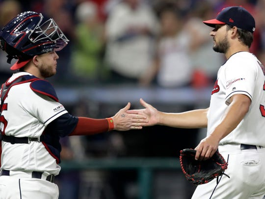 Cleveland Indians relief pitcher Brad Hand, right, is congratulated by catcher Roberto Perez after the Indians defeated the Detroit Tigers 7-6 in a baseball game Friday, June 21, 2019, in Cleveland. (AP Photo/Tony Dejak)