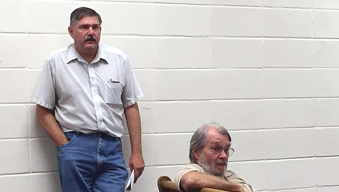 Chris Carter, at left, and Marion County Quorum Court member Mike Scrima listen to a question at Thursday's Marion County Planning Board meeting.