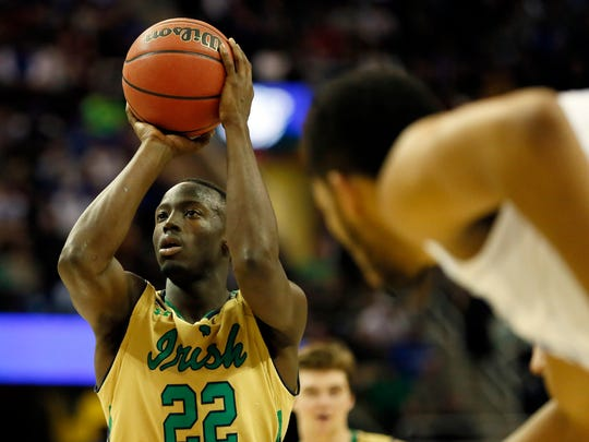 Notre Dame Fighting Irish guard Jerian Grant (22) shoots a free-throw during the second half against the Kentucky Wildcats in the finals of the midwest regional of the 2015 NCAA Tournament at Quicken Loans Arena.