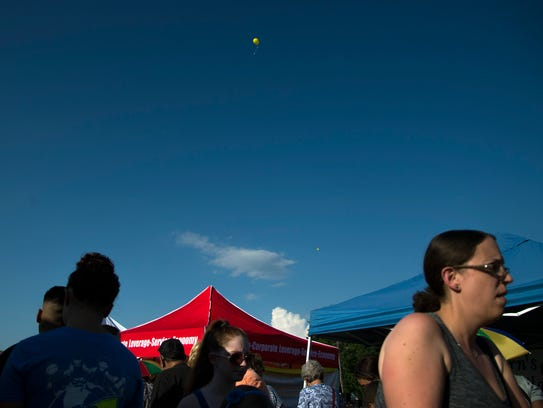 A balloon floats off during National Night Out Tuesday,