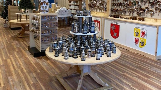 Holland Clock Co. merchandise on display in its new location at 39 E. Eighth Street. The store carries handcrafted cuckoo clocks, beer steins and ornaments from Germany.