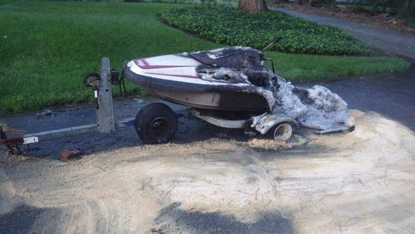 The burnt remains of a Jet Ski on trailer on Douglas Road in Salisbury.