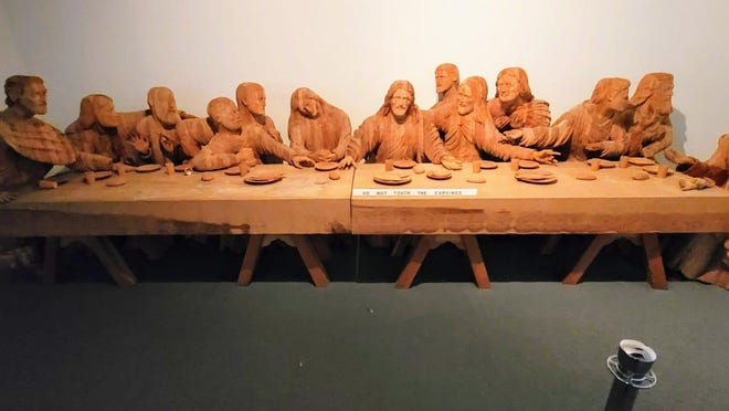 Mansfield's BibleWalk has a new collection of life-sized wooden biblical carvings including this version of the Last Supper, which took Joseph Barta four years to create.