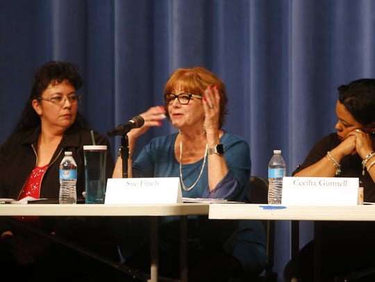 Bloomfield City Council candidate Sue Finch, center, responds to a question Tuesday during a candidate forum at Bloomfield High School. Mayoral candidate Cynthia Atencio and council candidate Cecilia Gunnell listen to Finch's response.