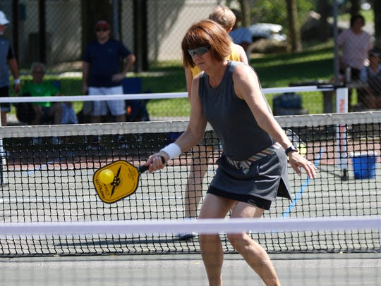 Kathy Amador returns a shot during a pickleball demonstration
