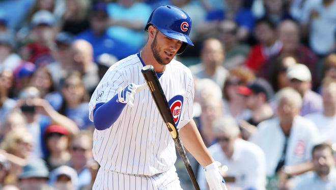 Chicago Cubs infielder Kris Bryant reacts after striking out against the San Diego Padres during the fourth inning at Wrigley Field.