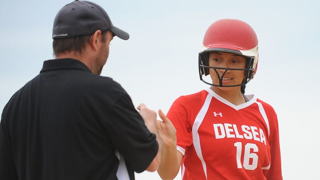 Delsea's Kendra Sample high fives coach Scott Gutelius after reaching base during the Hammonton Invitational Tournament championship game against Millville on Saturday.