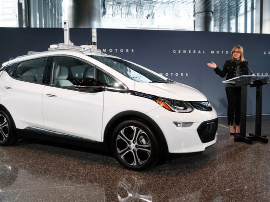 General Motors Chairman and CEO Mary Barra speaks next to a autonomous Chevrolet Bolt electric car Thursday, Dec. 15, 2016, in Detroit. General Motors has started testing fully autonomous vehicles on public roads around its technical center in suburban Detroit.