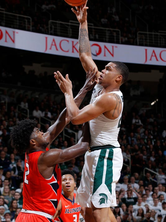 Michigan State's Miles Bridges, right, shoots over Illinois' Kipper Nichols during the second half of an NCAA college basketball game Tuesday, Feb. 20, 2018, in East Lansing, Mich. Michigan State won 81-61. (AP Photo/Al Goldis)
