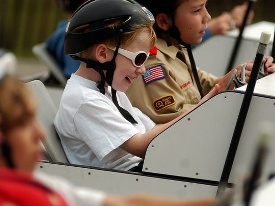 """Hunter Sullivan (center), then age 7, gets ready for a practice run in the New Berlin Soap Box Derby on Sept. 6, 2008. The long-running annual event, one of the city's unique elements, is expected to be included among the storylines in """"Around the Corner with John McGivern,"""" a Milwaukee PBS series, in early 2020. Filming is expected to begin July 30."""