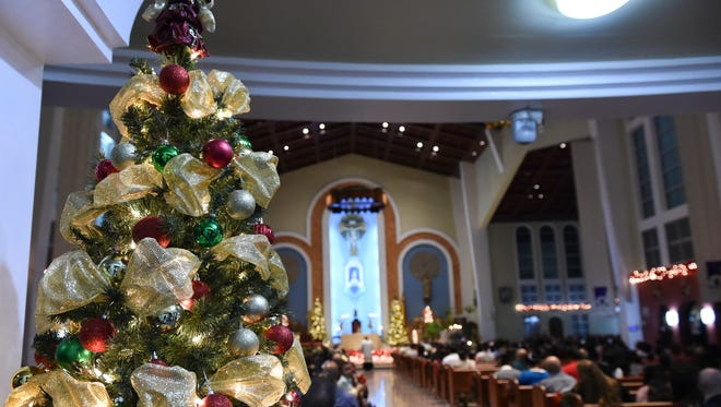 "The Dulce Nombre de Maria Cathedral-Basilica Christmas was festively decorated during its ""Christmas at Midnight"" mass in Hagatna on Dec. 25, 2016."